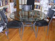 Glass and metal dining table and chairs
